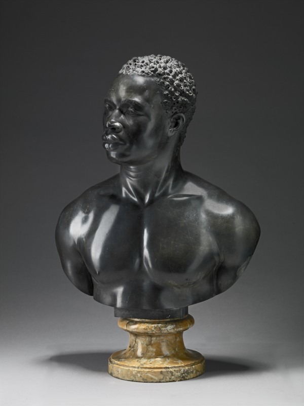 black limestone on a yellow marble socle, 71.1 × 50.8 × 26.7 cm. Yale Center for British Art, New Haven