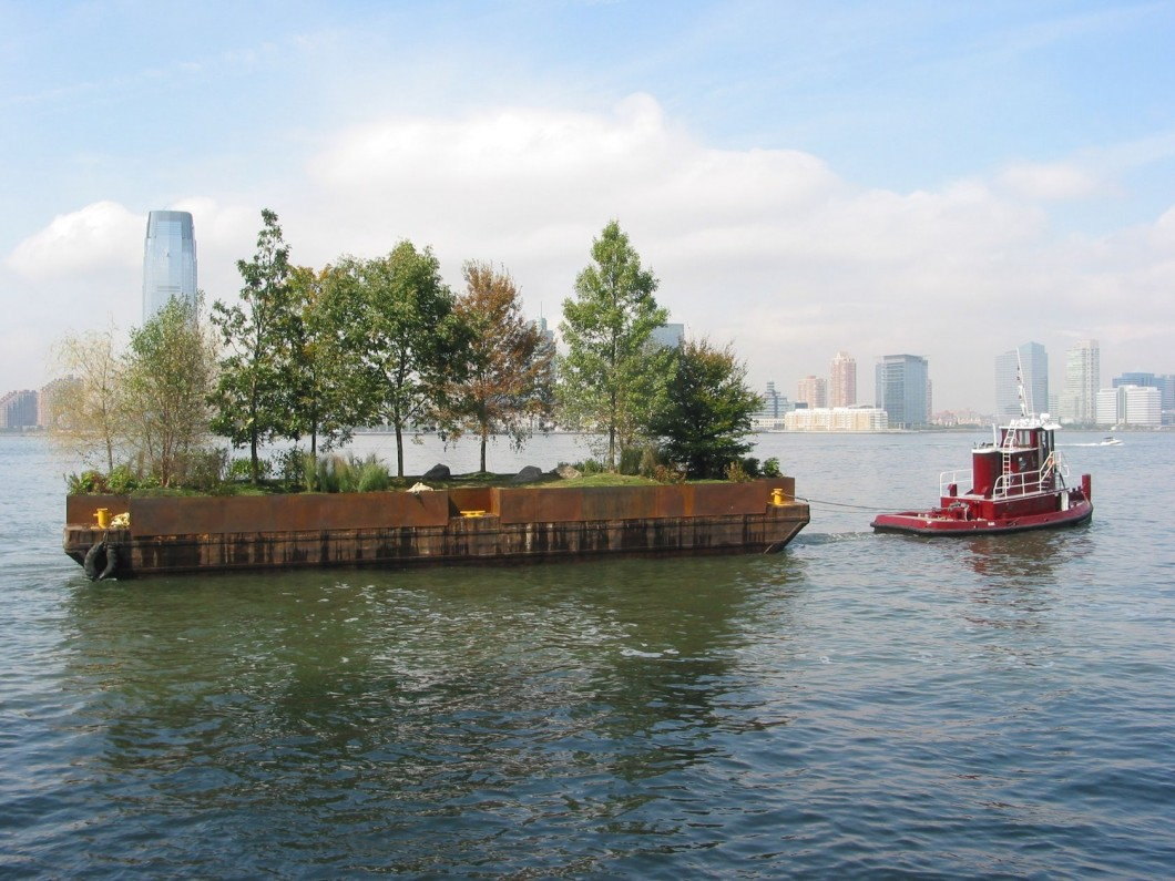 designed in 1970, built in 2005 , barge landscaped with earth, rocks, and native trees and shrubs, towed by a tugboat, 30 x 90 foot.