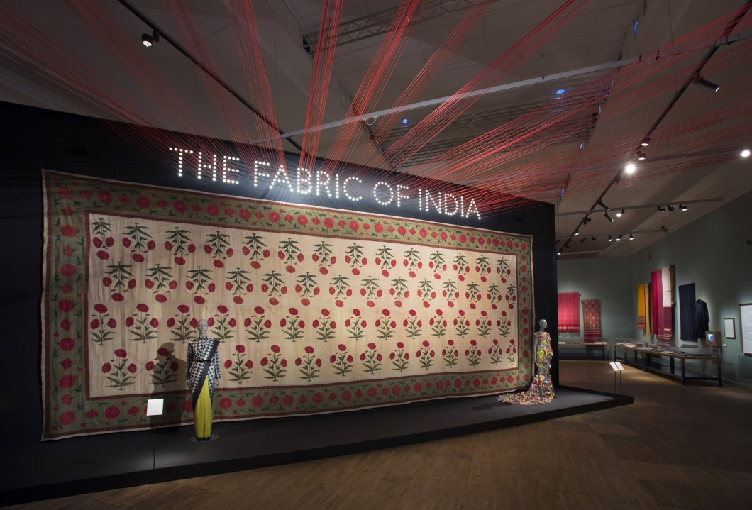 Decorated fabric hung on wall of exhibition