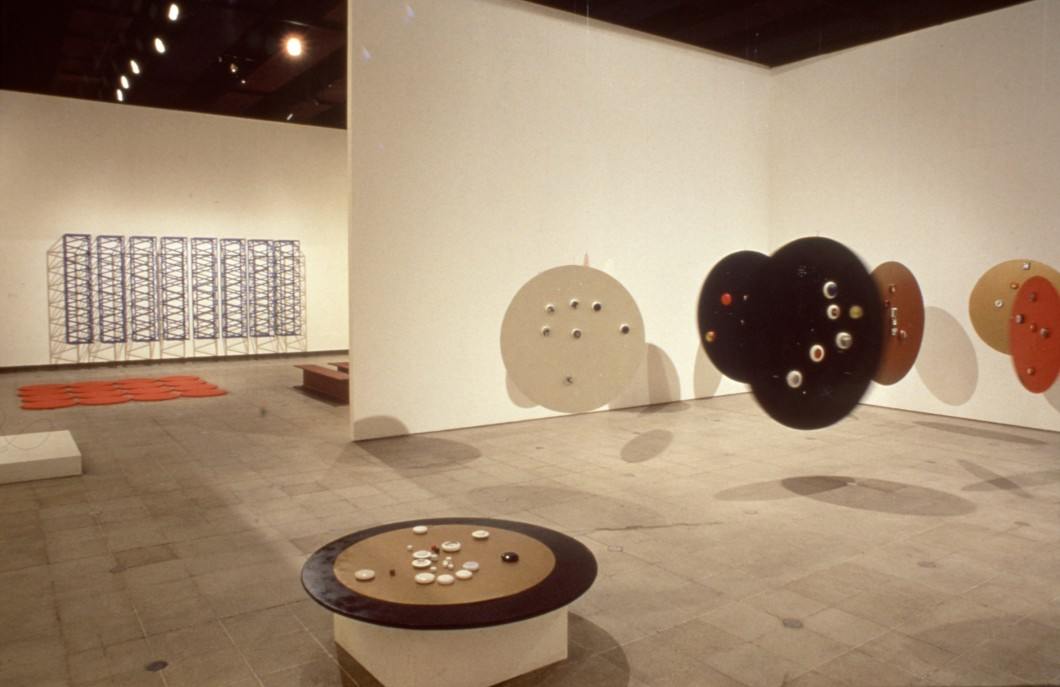 Circular sculptural forms installed in gallery space