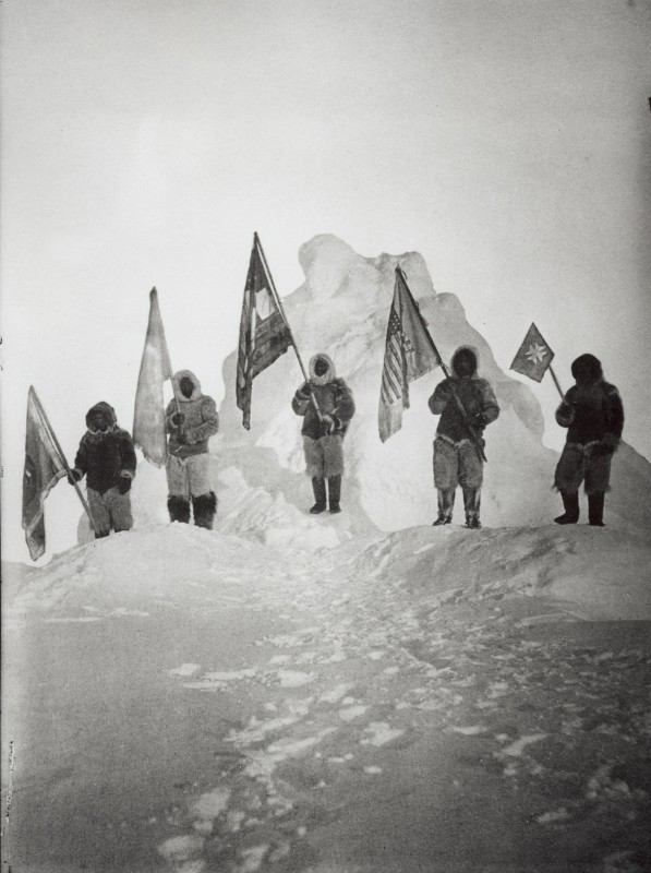 Photograph of the Robert Peary Sledge Party Posing with Flags at the North Pole